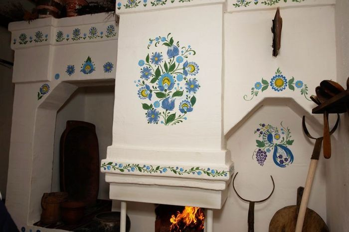 Как задекорировать печку в доме фото своими руками