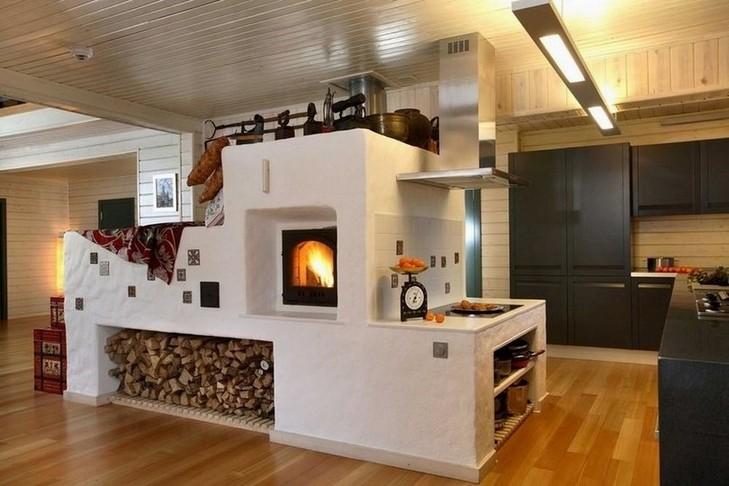 Русская печь в доме является очень полезным устройством. Она является частью системы отопления, на ней можно устроить лежак и она прекрасно дополняет интерьер.
