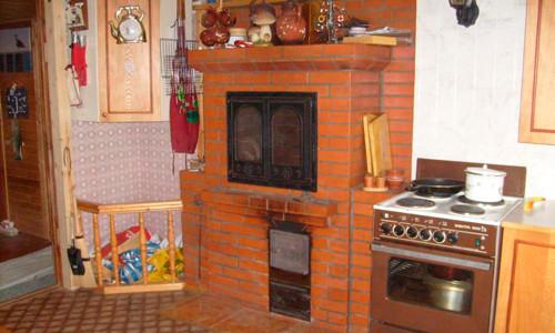 Печь-шведка в интерьере кухни